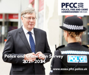 PFCC Roger Hirst talking to a police officer.